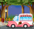 A pink ice cream car in the street