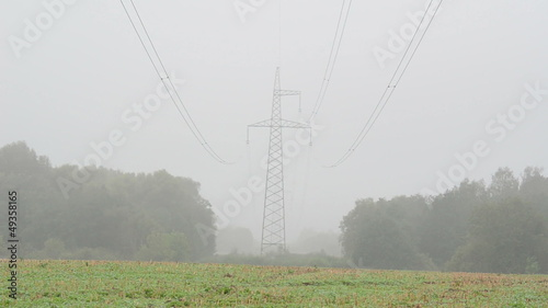 blur agriculture field high voltage electricity pole wire in fog