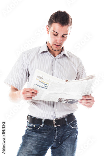 Portrait of a businessman reading a daily newspaper