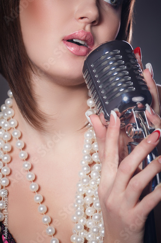 young singer with a retro microphone