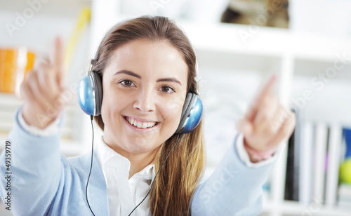 Happy young woman enjoying music