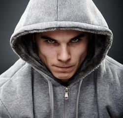 Close-up portrait of threatening thug
