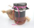 buckwheat honey with pink ribbon