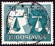 Stamp Yugoslavia 1958 White and Black Hands Holding Scales