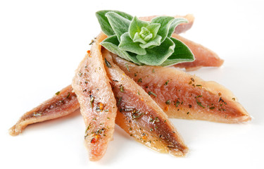 anchovies on white with spice and oregano