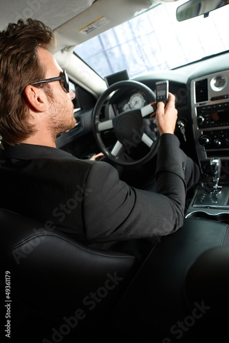 Young man driving a limousine