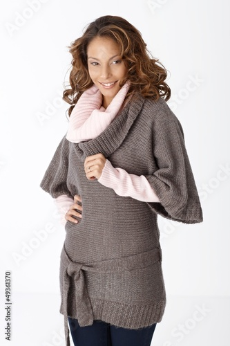 Beautiful smiling woman in warm clothes