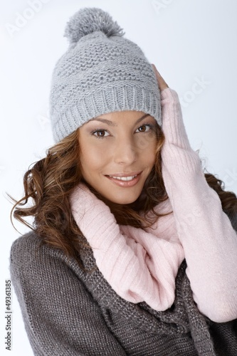 Beautiful ethnic woman dressed for winter