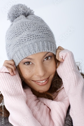 Closeup portrait of happy winter girl