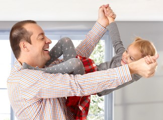 Father and little daughter playing laughing