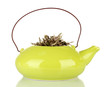 Dried herbs in teapot, isolated