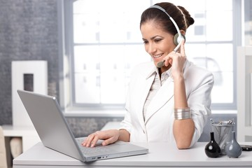 Smiling receptionist with headset