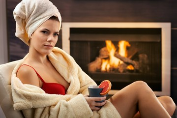 Pretty woman relaxing in bra and bathrobe