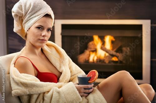 Pretty woman relaxing in bra and bathrobe
