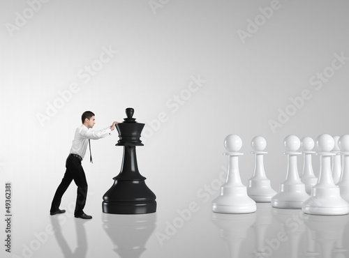 man moving chess