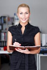 Businesswoman with checklist