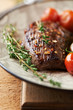 Close up of grilled beef steak with thyme