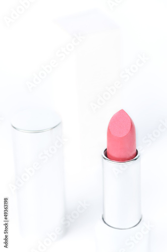 lipstick and its cup
