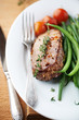 Rustic beef steak with herbs and vegetables