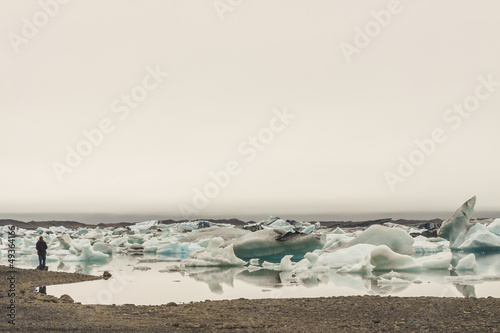 Person on coast of Jokulsaron lagoon.