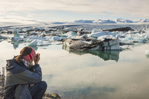 Photographer on coast of Jokulsarlon lagoon - Iceland.