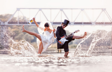 Bride and groom is happy in the river