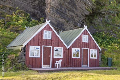 Two red wooden cottage - Vik, Iceland. - 49364743