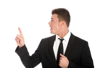 Stunned businessman pointing upward