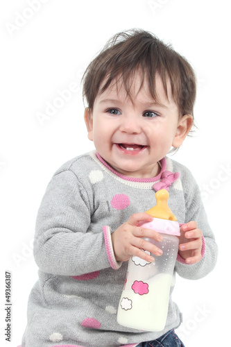 Happiness baby holding a feeding bottle