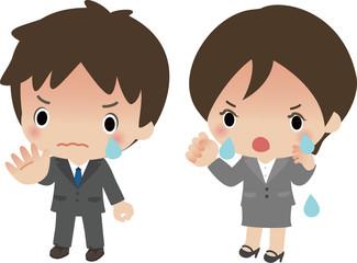 泣きながら抗議する若いスーツの男女