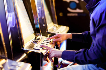 Man using an electronic slot machine