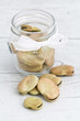 Beans in glass jar on wooden background