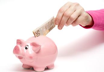 Rosa Sparschwein mit Geldschein