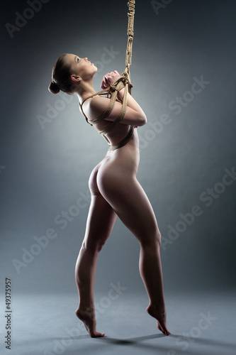Slim young woman with shibari