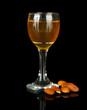 Tasty color liquor, isolated on black