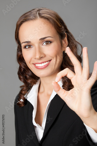 Young businesswoman showing okay gesture