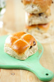 hot cross buns on wooden board, shallow dof