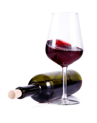 wine glass with red wine and lying bottle of wine