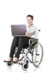 Disabled businesswoman sitting in a wheel chair