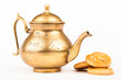old brass teapot and sweet cookies isolated on white