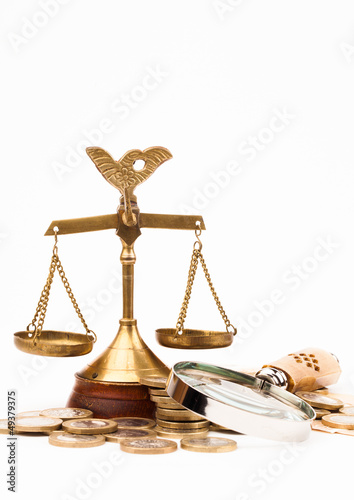 money , magnifying glass and scales of justice