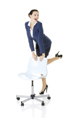 Businesswoman standing next to ofice chair