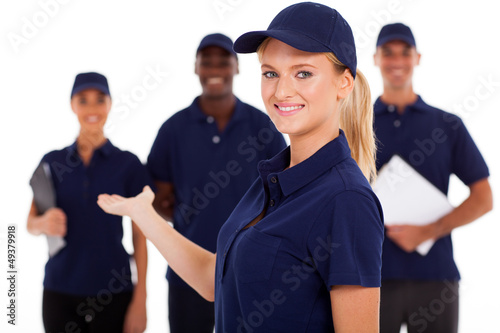 pretty female technical service worker presenting team on white