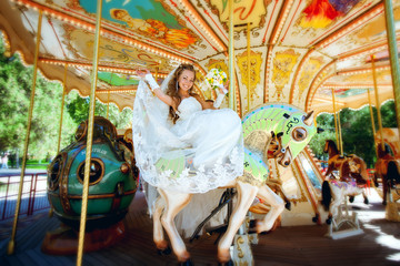 beautiful bride riding a carousel