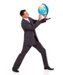 young businessman holding a globe isolated on white