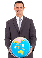 young handsome busniessman holding a globe