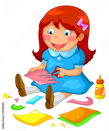 little girl making crafts from paper