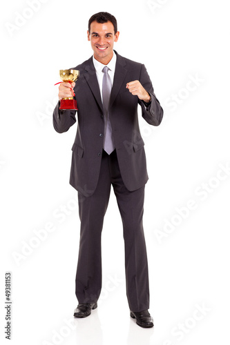handsome young businessman holding trophy isolated on white