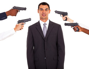 businessman being attacked at gun point by colleagues