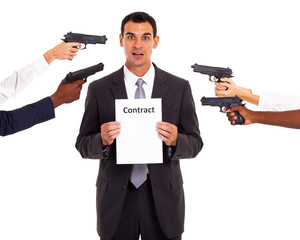 businessman holding forced contract at gun point